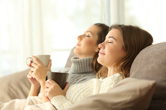 Roommates relaxing in winter on a couch