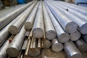 Pile of metal rods. Stainless steel bars.