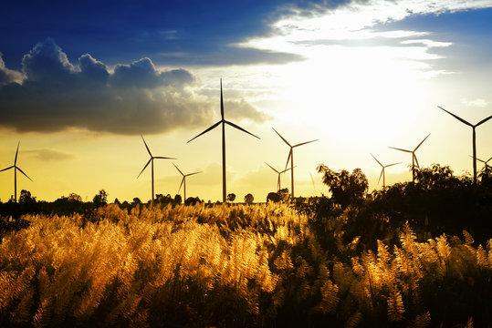 Eco power ,wind turbine power generator at twilight