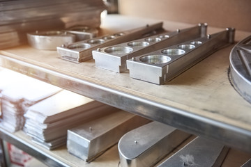 Stainless steel parts on shelf. Gray metal parts.
