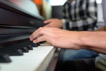 pressing a piano