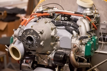 Small airplane engine. Engine front part.