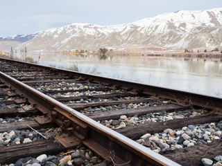 Railroad tracks running along the snow covered Columbia river valley north of Wenatchee, Eastern Washington state