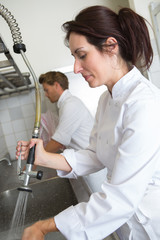 female employee washing dishes at the restaurant