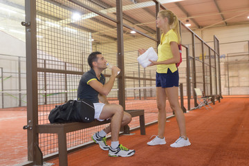 couple of tennis players talking after a match