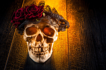 A skull with a wreath of roses.