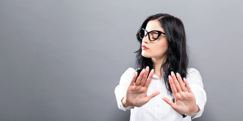Young woman making a rejection pose a solid background Wall mural