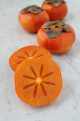 Persimmons on Marble