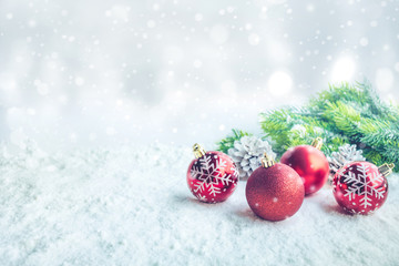 Christmas ball (ornament) on snow background.For christmas concepts or new year,celebration ideas.