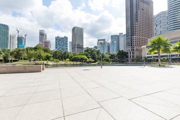 empty marble floor in midtown of modern city