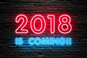 GET READY FOR 2018 NEW YEAR concept. 2018 IS COMING text fluorescent Neon tube Sign on dark brick wall. Front view. Can be used for online banner ads or background. night moment.