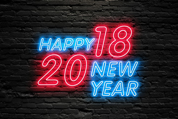 NEW YEAR CELEBRATTION concept. 2018 HAPPY NEW YEAR text fluorescent Neon tube Sign on dark brick wall. Front view. Can be used for online banner ads or background. night moment.