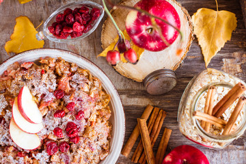 Oat flakes baked with apple, cherry and cinnamon. Ingredients for oatmeal preparation. Top view