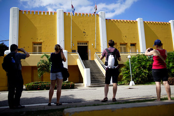 Tourists take pictures at the Moncada Army Barracks in Santiago