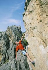 Rock climbing. A man climbs the rock.