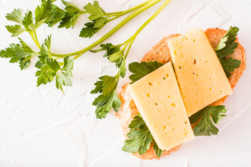 Hot sandwich with cheese and parsley. Top view