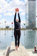 Woman Doing Yoga Near Lake In Urban Setting, Paris