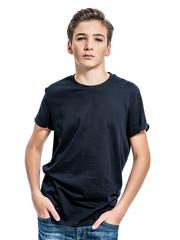 Photo of teenage handsome guy posing at studio