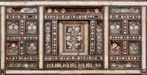 Closeup of wooden seamless floral pattern ornaments on old wooden chair