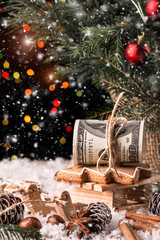 Money Christmas  Gift with wooden sled.