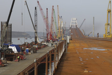 A general view shows a construction site of a road bridge, which is constructed to connect the Russian mainland with the Crimean peninsula, in the Kerch Strait