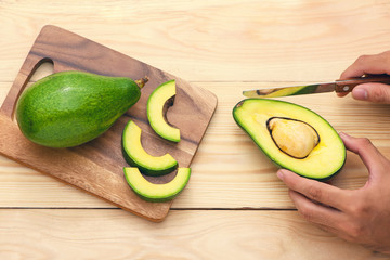 Healthy food concept. Eating fresh organic avocado