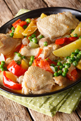 popular Filipino meal stew of chicken with vegetables - afritada closeup in a bowl. vertical