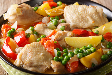 Philippine Food: Afritada Chicken with vegetables close-up. horizontal