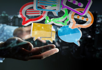 Businessman using digital colorful 3D rendering conversation icons