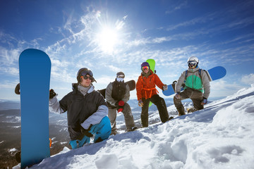 Four snowboarders at ski slope