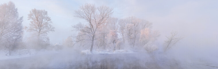 amazing landscape with frozen snow covered trees at sunrise
