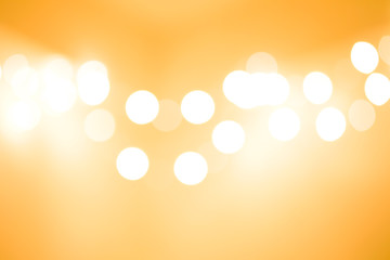 Abstract bokeh background of lights for Happy New Year and Merry Christmas, Gold tone