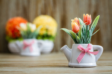 Artificial Tulips in White Porcelain Pots with Teapot Design and Pink Ribbon
