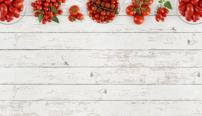 tomatoes top view on kitchen white wooden table copy space template