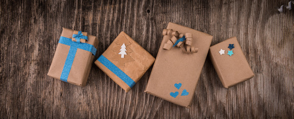 Vintage gift boxes with bow on wooden background