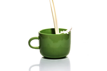 Cup with milk on a white background