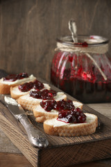 Sandwiches with butter and cranberry jam