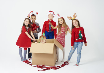Group of children preparing christmas surprise