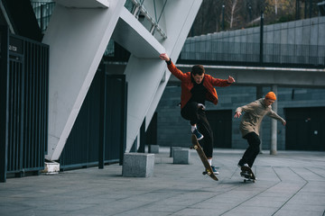 young men riding skateboards in urban location