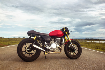 Vintage cafe racer motorcycle on the road. motorbike. Outdoors.