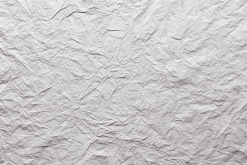 Grey crumpled paper texture.