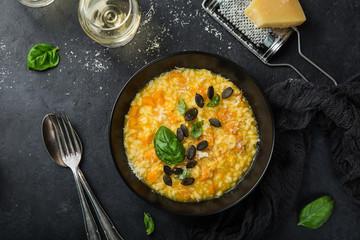 delicious pumpkin risotto, black background
