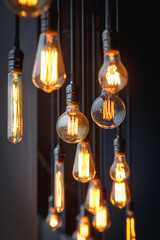 Diferent vintage tungsten filament lamps hanging from the ceiling