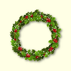 Christmas wreath of holly with red berries and snowflakes