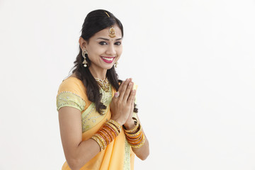 Indian woman in traditional clothing greeting