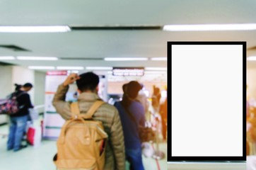 vertical advertising billboard or blank showcase light box for your text message or media content with people at immigration control in the airport, commercial, marketing and advertisement concept