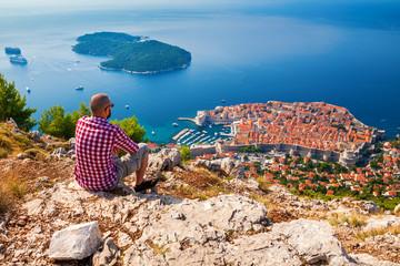man enjoying beautiful view of Dubrovnik Wall mural