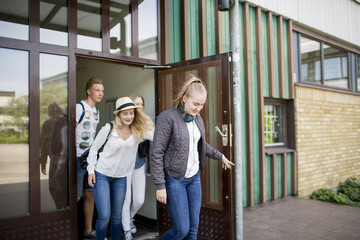 Teenagers leaving school building