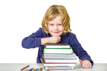 Girl with a stack of books and crayons
