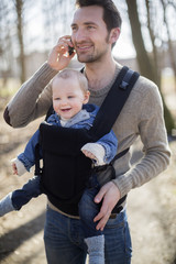 Man with baby boy in carrier